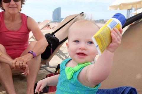 baby holding sunscreen